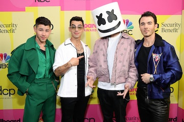 (L-R) Nick Jonas and Joe Jonas of Jonas Brothers, Marshmello, and Kevin Jonas of Jonas Brothers pose backstage for the 2021 Billboard Music Awards, broadcast on May 23, 2021 at Microsoft Theater in Los Angeles, California. (Photo by Rich Fury/Getty Images for dcp)