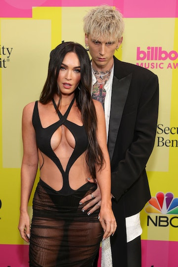 Machine Gun Kelly and Meghan Fox poses backstage for the 2021 Billboard Music Awards, broadcast on May 23, 2021 at Microsoft Theater in Los Angeles, California. (Photo by Rich Fury/Getty Images for dcp)