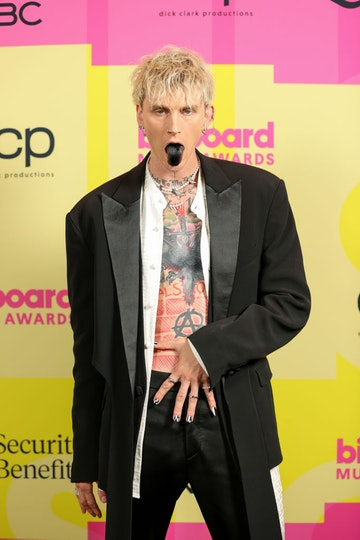 Machine Gun Kelly poses backstage for the 2021 Billboard Music Awards, broadcast on May 23, 2021 at Microsoft Theater in Los Angeles, California. (Photo by Rich Fury/Getty Images for dcp)