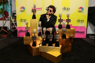 The Weeknd, winner of the Top Artist Award, Top Male Artist Award, Top Hot 100 Artist Award, Top Radio Songs Artist Award, Top R&B Artist Award, Top R&B Album Award, Top Billboard 200 Album Award, Top Hot 100 Song Presented by Rockstar Award, Top Radio Song Award, and Top R&B Song Award poses backstage for the 2021 Billboard Music Awards, broadcast on May 23, 2021 at Microsoft Theater in Los Angeles, California. (Photo by Rich Fury/Getty Images for dcp)